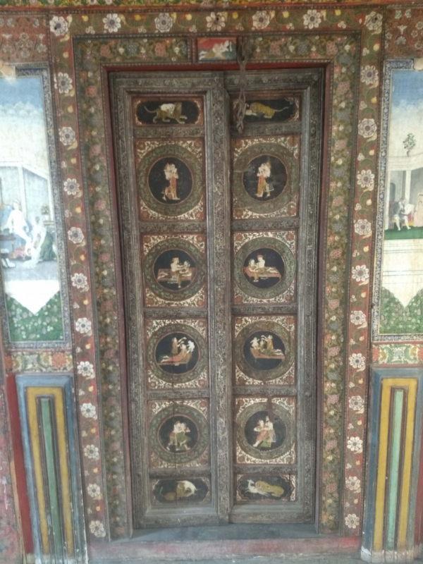 An ornately painted door inside Tambekar Wada.
